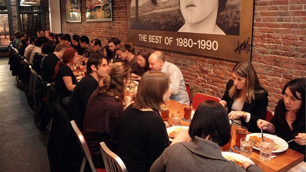 The Salty Tongue in Vancouver features long-table nights, where strangers sit elbow-to-elbow and dine together.