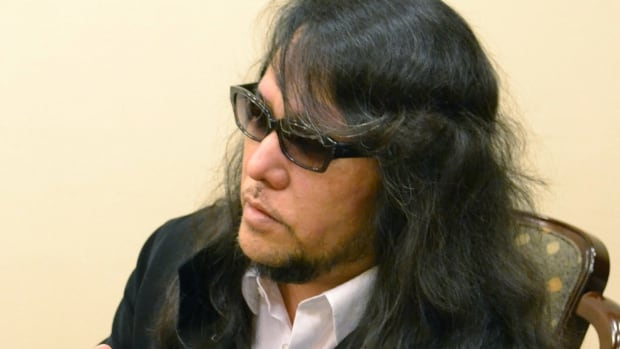 Deaf composer Mamoru Samuragochi, seen in Hiroshima in December, has confessed to hiring someone to write his music for nearly two decades, including his most iconic works.