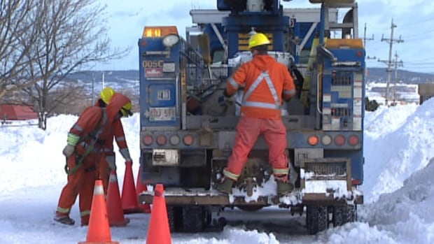 Newfoundland Power crews seen working to restore power to people in St. John's during the island's widespread outages in January.