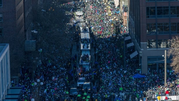 The NFL's Seahawks, winners of Super Bowl XLVIII, ride aboard trolleys during Wednesday's victory parade in Seattle, Wash.