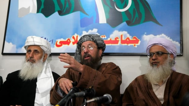 Maulana Sami ul-Haq, centre, one of the Taliban negotiators, speaks during a news conference with his team members Ibrahim Khan, left, and Maulana Abdul Aziz, right, in Islamabad.