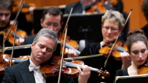 Concertmaster Frank Almond plays a 300-year-old Stradivarius violin that was on loan to him, during a concert in Milwaukee. Police say three people have been arrested in connection with the theft of the multi-million-dollar instrument, which may have been recovered.