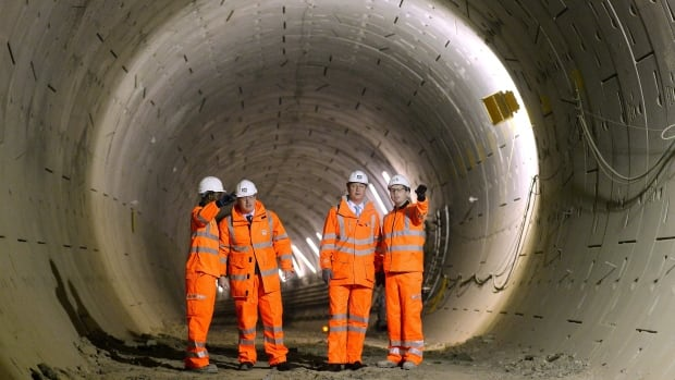 Britain's Prime Minister David Cameron, second right, and Mayor of London Boris Johnson, second left, visit a Crossrail construction site underneath Tottenham Court Road in central London, on Thursday Jan. 16, 2014. The Crossrail project, which is expected to be completed in 2018, will link Berkshire, west of London with Essex, east of London.