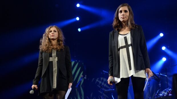 Pussy Riot members Maria Alekhina, left, and Nadya Tolokonnikova speak at Amnesty International's Bringing Human Rights Home Concert at the Barclays Center in New York on Wednesday.