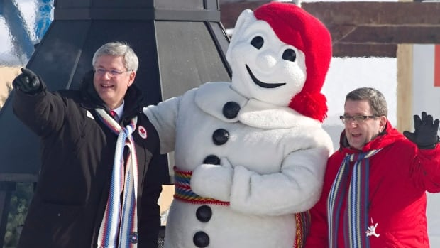 Prime Minister Stephen Harper and Quebec City Mayor Regis Labeaume pose with Bonhomme, the Quebec winter carnival mascot, in Quebec City on Feb. 6, 2014. Harper also sat down with the Chamber of Commerce to discuss the economy and the recently signed Canada-EU free trade agreement.