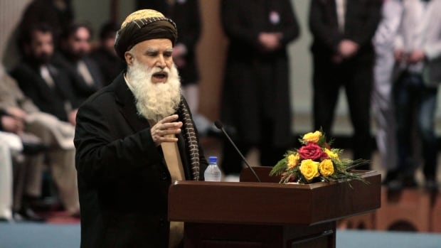 Afghan presidential candidate and former warlord Abdul Rab Rasoul Sayyaf speaks during a campaign rally in Kabul, Afghanistan, Thursday, Feb. 6, 2014.