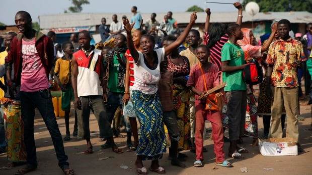 Christians cheered as a Muslim convoy of some 500 cars, trucks and motorcycles made its way toward Chad, a predominantly Muslim neighbouring country.