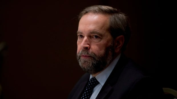 Federal NDP Leader Thomas Mulcair tied Rob Ford to federal Conservatives in Toronto on Friday.