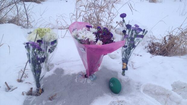 A memorial is set up along the South Saskatchewan River.