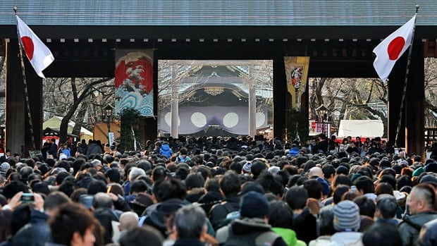 People wait to offer New Year prayers at Yasukuni Shrine in Tokyo on Jan. 1. 2014. Both Prime Minister Shinzo Abe and a Japanese cabinet member had just visited the shrine, seen by critics as a symbol of Japan's wartime aggression.