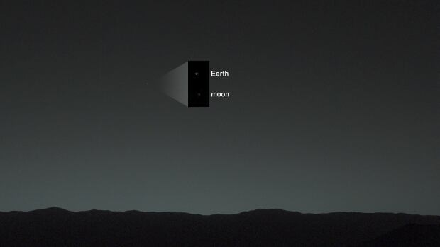 This view of the twilight sky and Martian horizon taken by NASA's Curiosity Mars rover includes Earth as the brightest point of light in the night sky.
