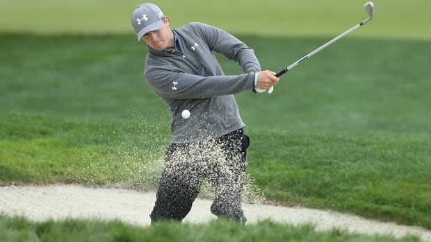 Co-leader Jordan Spieth blasts out of a bunker in the second round of the AT&T Pebble Beach National Pro-Am on Thursday.
