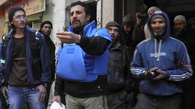 UN workers help with the distribution of humanitarian aid in Homs, Syria.