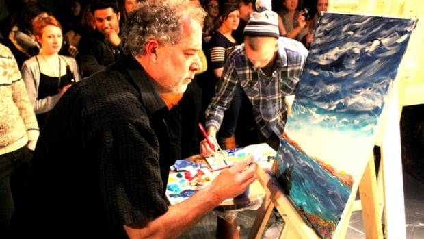 Artists faceoff during Art Battle in Halifax earlier this month.