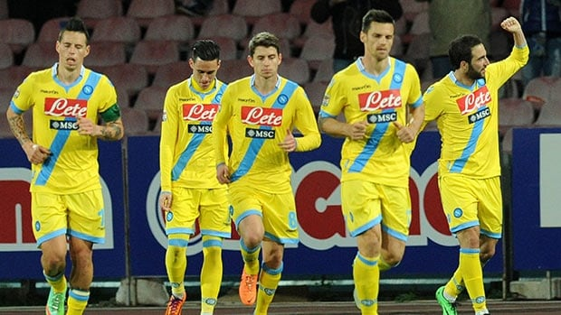 Napoli players celebrate after scoring against AC Milan at Stadio San Paolo on February 8, 2014 in Naples, Italy.
