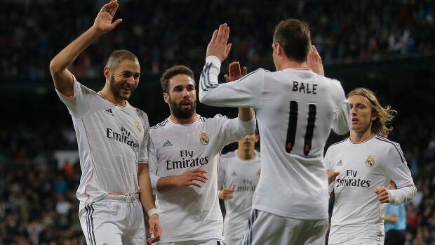 Real Madrid players celebrate a goal against Villarreal at the Bernabeu stadium in Madrid, Spain, Saturday, Feb. 8, 2014.