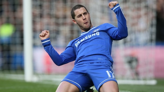 Chelsea's Eden Hazard celebrates after scoring against Newcastle United in London, Saturday, Feb. 8  2014.
