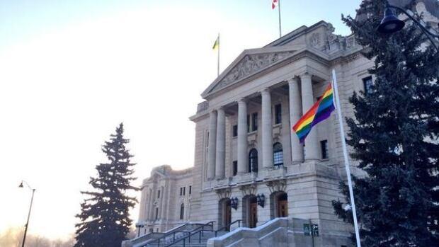 The rainbow flag flies in front of the Saskatchewan legislature building in Regina.