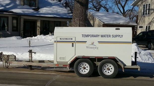 A temporary water supply tank is parked on Lyndale Drive on Sunday morning, as crews repair a water main break between Ashdale Avenue and Highfield Street.