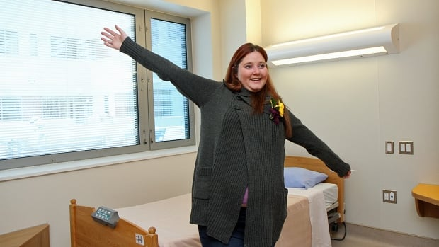 Jessica Bennett, 26, shows off her room in St. Joseph Healthcare Hamilton's new West 5th facility on Sunday, Feb. 9, 2014.