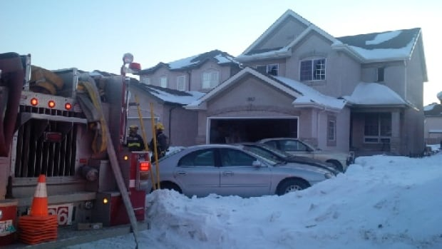 Winnipeg fire crews attend to a house fire on Hindle Gate on Sunday afternoon.