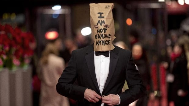 Shia LaBeouf hit the red carpet at the Berlin Film Festival wearing a paper bag emblazoned with the words 'I am not famous anymore' over his head.