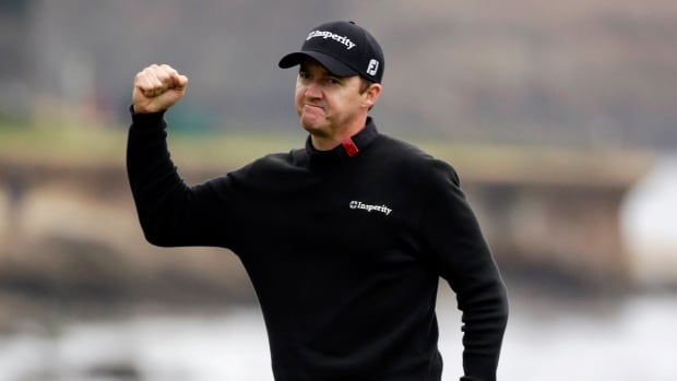 Jimmy Walker celebrates on the 18th green Sunday, Feb. 9, 2014, after winning the AT&T Pebble Beach Pro-Am golf tournament in Pebble Beach, Calif.
