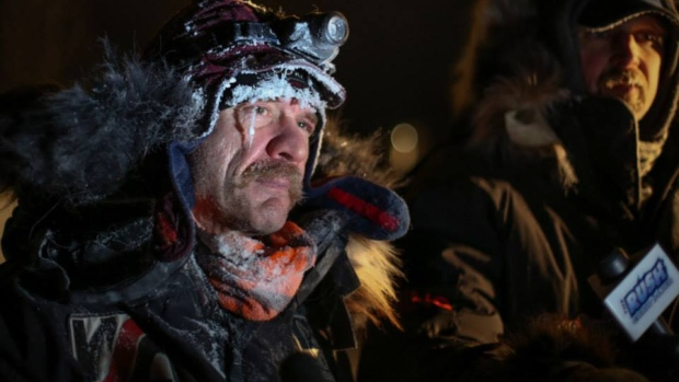 Musher Allen Moore was the first to cross the finish line at Takhini Hot Springs early Monday morning making him the 2014 Yukon Quest winner.