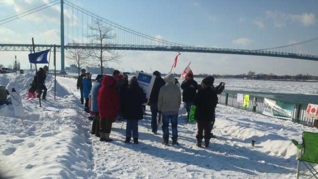 Residents protest an appeal made by Detroit Bulk Storage to stockpile pet coke along the river.