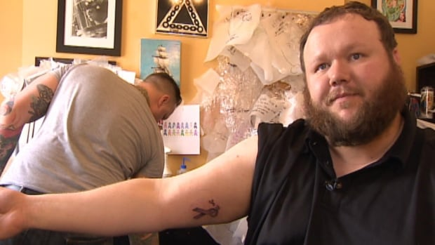 Wayne Fitzpatrick got a tattoo of the purple cancer ribbon in memory of relatives who died of the disease.