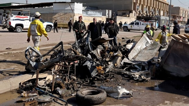 Security forces inspect the site of a car bomb attack in Baghdad's Karrada neighborhood earlier this month. Militants were attending a lesson Monday on making car bombs and explosive belts at a camp near the town of Samarra when a glitch set off one of the devices.