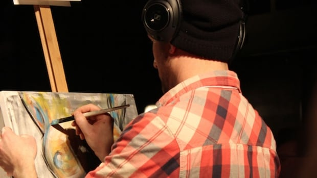 Jeff Kelly works on the competition-winning painting at Saturday's Art Battle in Charlottetown.