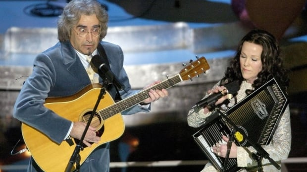 Eugene Levy and Catherine O'Hara, seen performing their Oscar-nominated original song A Kiss at the End of the Rainbow from A Mighty Wind during the 2004 Academy Awards. The SCTV alums have memorably teamed up in several Christopher Guest mockumentaries.