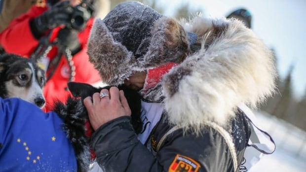 Musher Hugh Neff celebrating after crossing the Yukon Quest finish line at Takhini Hot Springs, Yukon making him the official runner up.