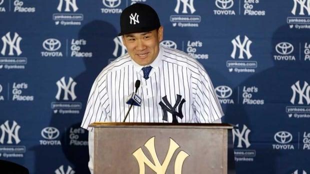 Yankees pitcher Masahiro Tanaka is introduced to the New York media on Tuesday.
