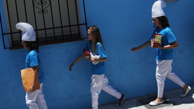 Children dressed up as Smurfs take part in a promotional event in the Andalusian village of Juzcar in southern Spain in 2011. The facades of the houses were painted blue as part of a global promotion for the  film The Smurfs II and the village has been a tourist attraction ever since.