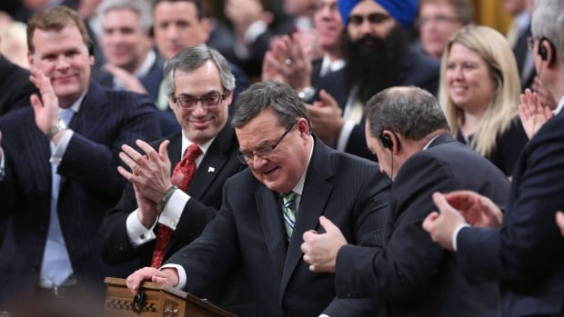 Finance Minister Jim Flaherty is applauded by his caucus as he arrives to table the budget in the House of Commons on Feb. 11. The future home of Finance Canada will carry his name.