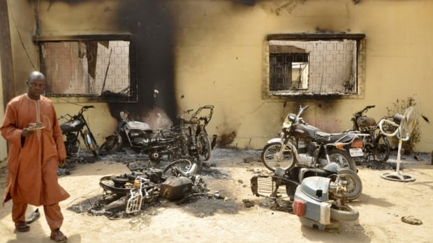 A man walks through the ruins of a police headquarters after a Boko Haram bomb attack in Kano, Nigeria, last month. Numerous villages in the area have been attacked and hundreds have been killed in recent months despite a nine-month-long military state of emergency.