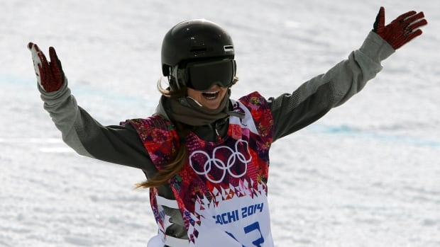 Canada's Alexandra Duckworth opens her arms in celebration after competing in the women's snowboard halfpipe qualifying round at the Rosa Khutor Extreme Park at the 2014 Winter Olympics