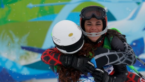 Lebanon's Jackie Chamoun, left, embraces compatriot Chirine Njeim at the Vancouver 2010 Winter Olympics in Whistler, B.C., in 2010. This year, photos of her meant for a calendar are causing an uproar.