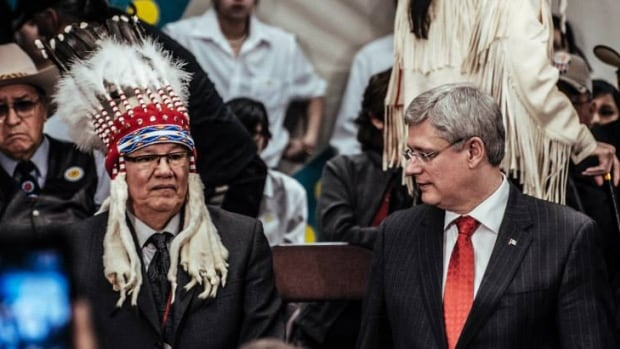PM Stephen Harper unveiled his government's plan to reform First Nations education last week, at Blood Tribe Reserve in Alberta.  Pictured here with Chief Weasel Head.