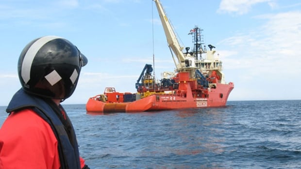 A Husky Energy employee monitors a test for a temporary guide base in Freshwater Bay.