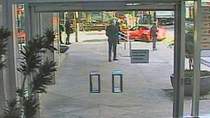 Video red camaro driving erratically on sidewalk