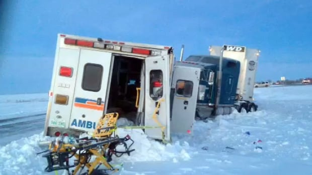 An ambulance and a semi-truck were still in the ditch west of Regina early Thursday morning. They were pulled out later in the day.
