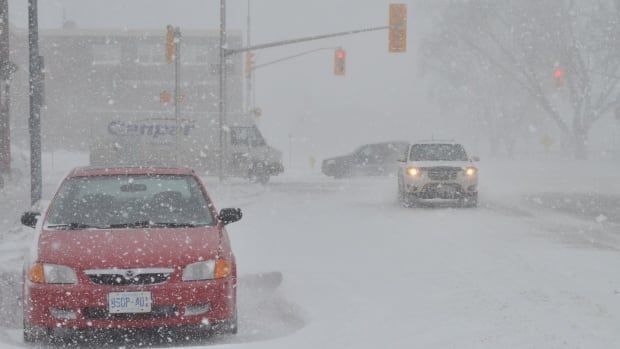 "An ""Alberta clipper"" snowstorm brought high winds and low visibility to Thunder Bay Thursday."
