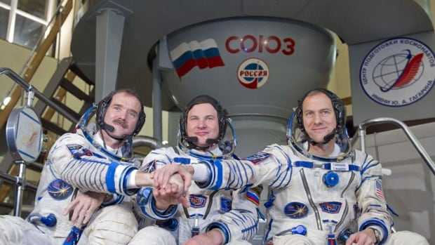 Canadian astronaut Chris Hadfield, left, poses with Russian cosmonaut Roman Romanenko and U.S. astronaut Thomas Marshburn in 2012. Hadfield said that behind what may seem at times like a brusque exterior, Russians are warm and generous people.