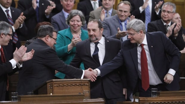 Prime Minister Stephen Harper, right, shakes hands with Finance Minister Jim Flaherty after he tabled the federal budget in the House of Commons on Tuesday.