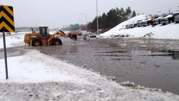 Water covers a stretch of Wheeler Boulevard on Friday.