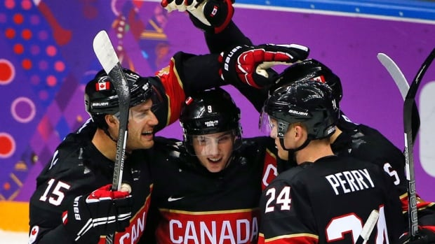 Team Canada celebrates a first period goal against Austria during a men's ice hockey game at the 2014 Winter Olympics, Friday, Feb. 14, 2014, in Sochi, Russia.
