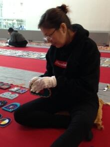 Tanya Kappo working on WWOS exhibit